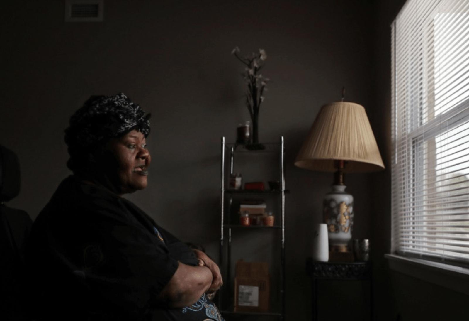 women in dark room